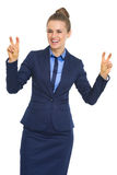 Smiling business woman making finger quote marks royalty free stock photos