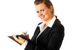 Smiling business woman making notes in document Royalty Free Stock Photography