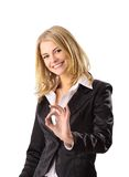 Smiling business woman making ok sign Stock Images