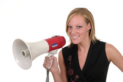 Smiling Business Woman With Megaphone 1. Attractive and smiling young executive business woman making her point really clear with the aid of a megaphone Royalty Free Stock Photo