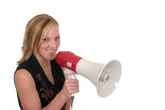 Smiling Business Woman With Megaphone 2. Attractive and smiling young executive business woman making her point really clear with the aid of a megaphone Royalty Free Stock Image