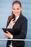 Smiling business woman with mobile and clipboard Stock Images