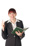 Smiling business woman with notebook in hand Stock Images