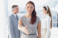 Smiling business woman offering handshake Stock Photo