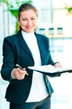 Smiling business woman offers to sign the document Royalty Free Stock Photos