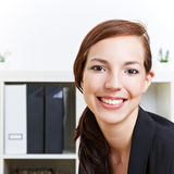 Smiling business woman in office Stock Photo