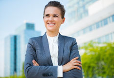 Smiling business woman in office district looking into distance Stock Photos