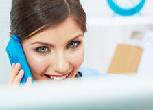 Smiling business woman on phone at office. Close up female port Royalty Free Stock Photography