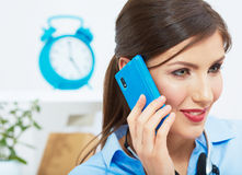 Smiling business woman on phone at office. Close u Stock Images