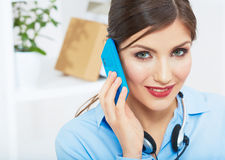 Smiling business woman on phone at office. Close u Royalty Free Stock Photo