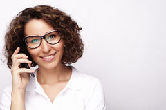 Smiling business woman phone talking, isolated on grey backgroun Royalty Free Stock Photography