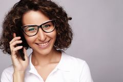 Smiling business woman phone talking, isolated on grey backgroun Stock Photos