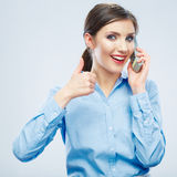 Smiling business woman phone talking portrait. Thumb show Stock Photography