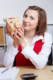 Smiling business woman with piggy Stock Images