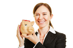 Smiling business woman with piggy bank Stock Images