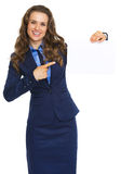 Smiling business woman pointing on blank paper sheet Royalty Free Stock Photo