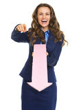 Smiling business woman pointing in camera with arrow Royalty Free Stock Photos