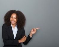 Smiling business woman pointing finger Stock Photography