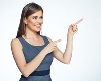 Smiling business woman pointing finger on copy space Stock Images