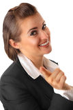 Smiling business woman pointing finger at you. Smiling modern business woman pointing finger at you isolated on white royalty free stock photos