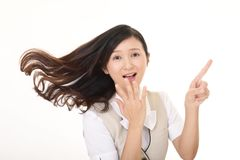 Smiling business woman. Business woman pointing with her finger Stock Photo