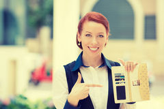 Smiling business woman pointing at many credit cards in her wallet. Portrait of young smiling business woman holding pointing at many credit cards in her wallet Royalty Free Stock Images