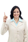 Smiling business woman pointing up Stock Photo