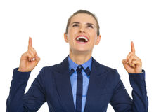 Smiling business woman pointing up on copy space Stock Photography