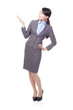Smiling business woman presenting Royalty Free Stock Photos