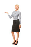 Smiling business woman presenting a copyspace Royalty Free Stock Photo