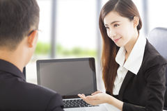 Smiling Business woman presenting and explaining a project royalty free stock image