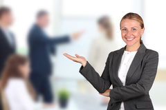 Smiling business woman presenting. Presentations. The smiling business woman presenting. Presentations Stock Photos