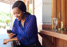 Smiling business woman reading text message on cell phone Stock Images