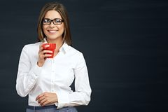 Smiling business woman with red coffee cup. Black background Stock Images