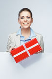 Smiling business woman red gift box hold. Royalty Free Stock Photography
