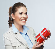 Smiling business woman red gift box hold. Stock Image