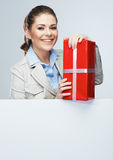 Smiling business woman red gift box hold. Royalty Free Stock Photos