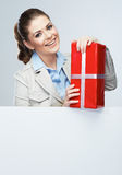 Smiling business woman red gift box hold. Stock Images
