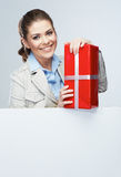 Smiling business woman red gift box hold. White card Stock Photos