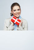 Smiling business woman red gift box hold. White card Royalty Free Stock Images
