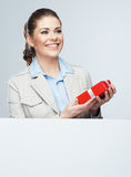 Smiling business woman red gift box hold. White card Royalty Free Stock Photo