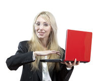 Smiling business woman with the red laptop Stock Image