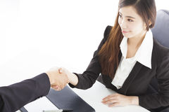 Smiling business woman shaking hands with client royalty free stock photo