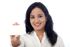 Smiling business woman showing blank business card Royalty Free Stock Photo