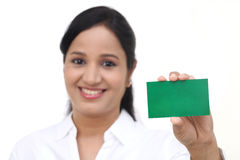 Smiling business woman showing blank card Royalty Free Stock Photos