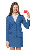 Smiling business woman showing blank credit card in blue suit, isolated over white background Stock Photo