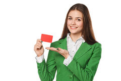 Smiling business woman showing blank credit card in green suit, isolated over white background Stock Images