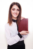Smiling business woman showing book Stock Photos