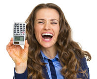 Smiling business woman showing calculator with hello inscription Stock Photo