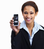 Smiling business woman showing cellphone on white Stock Image